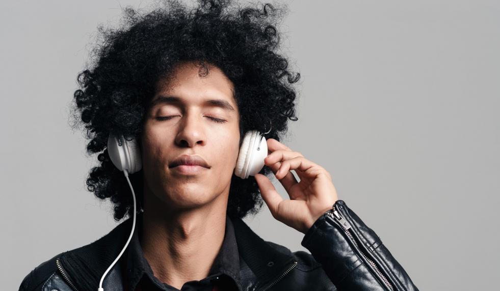 man-in-black-jacket-listening-to-music
